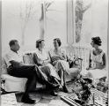J. William Fulbright, wife Betty, and daughters, on porch [of Washington residence].