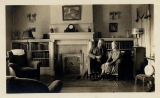 In living room of W. S. Campbell home on Lafayette Street, Fayetteville, Ark.