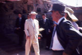 Frank Lloyd Wright in a Pale Suit outside with Men in Dark Suits at Taliesin West Easter...