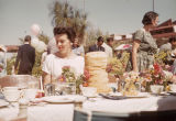 Gus Jones Sitting at a Flower-bedecked Table at Taliesin West Easter Celebration